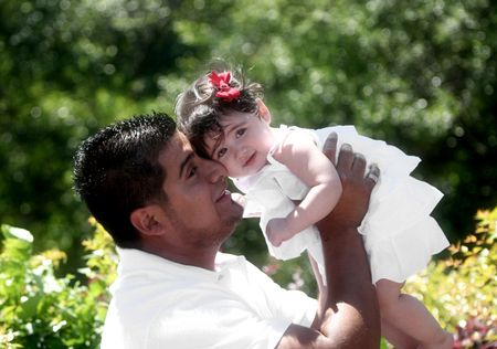 Young Hispanic Father with Daughter, Afternoon in the Park photo