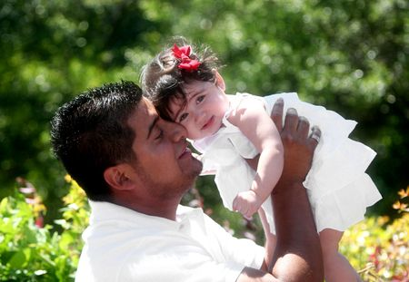 Young Hispanic Father with Daughter, Afternoon in the Park