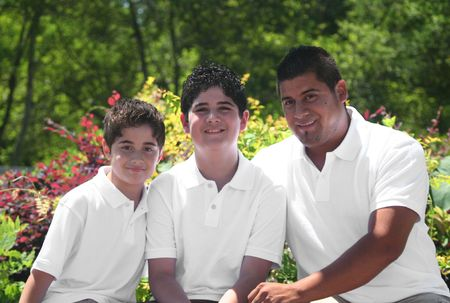 Young Hispanic Father With His Two Sons, Afternoon in the Park