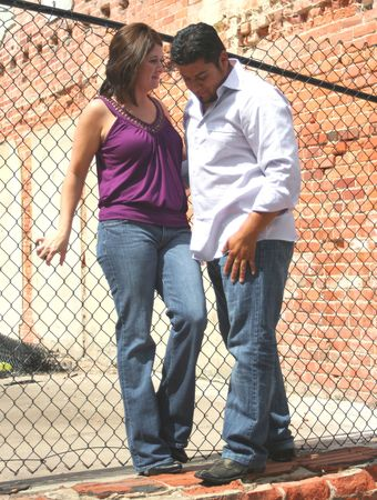 Young Hispanic Couple Hanging out in an Alley Stock Photo