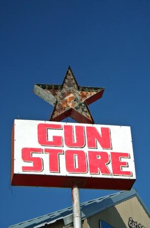 Vintage Gun Store Sign Stock Photo