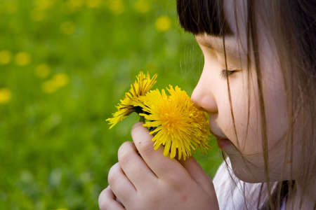 smells: Girl smells flowers Stock Photo