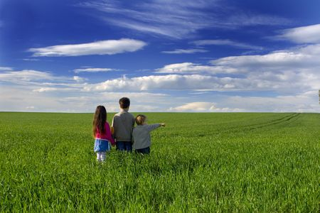Children in a meadow Stock Photo