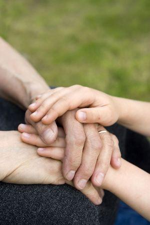 Hands of grandma and child Stock Photo