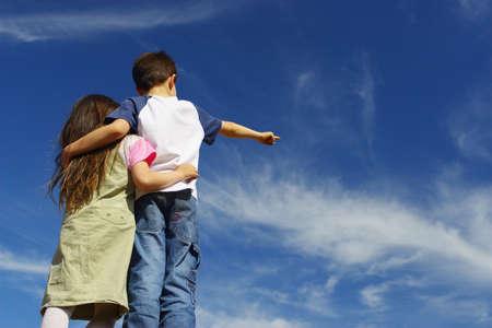 Boy with girl on the sky
