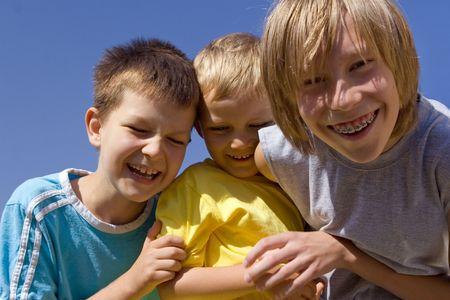 Smiling boys on blue sky Stock Photo - 720892