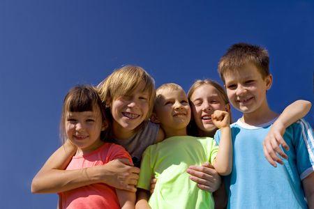 Smiling children on blue sky Stock Photo - 720869