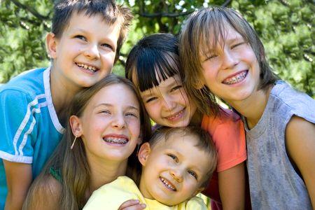 Cinco caras de niños felices Foto de archivo - 720873