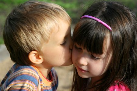 Boy kissing his lovely sister Stock Photo - 722751