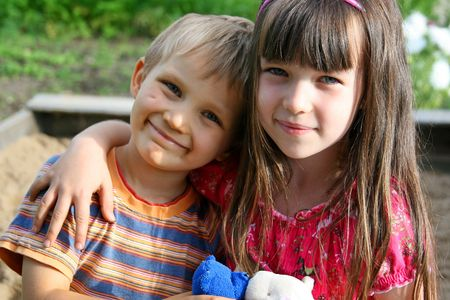 hearted: Happy sister and brother in garden