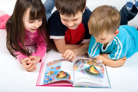 learning to read: children reading a book