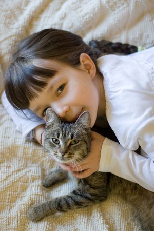 housecat: cat and girl Stock Photo