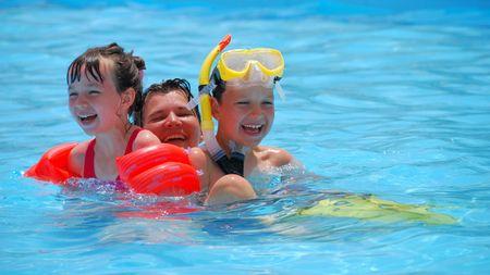 snorkelers: happy children with mother