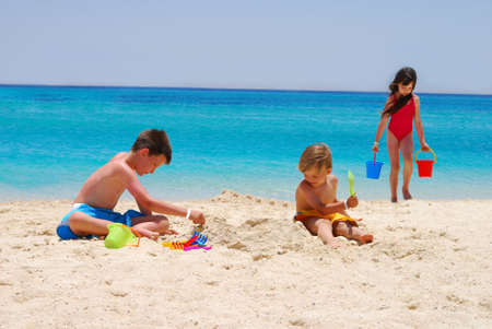 sand toys: Children Play at Island Beach