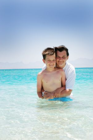 Mother and son in water photo
