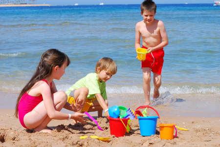 children playing at the beach Reklamní fotografie