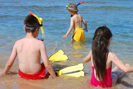 snorkelers: children playing at the beach Stock Photo