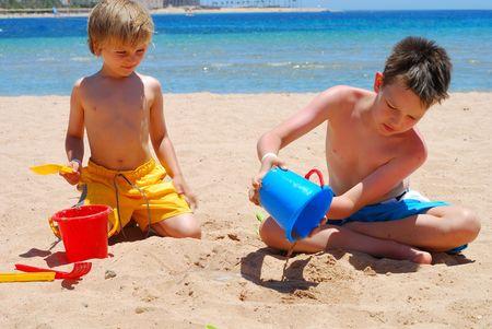 boys at beach Stock Photo