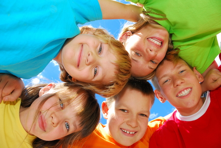huddle: Happy Kids in a Huddle