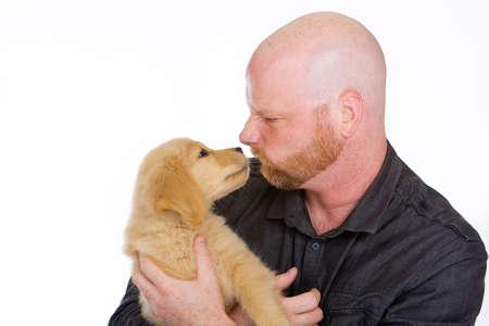 bald man: Man and puppy stubborn standoff