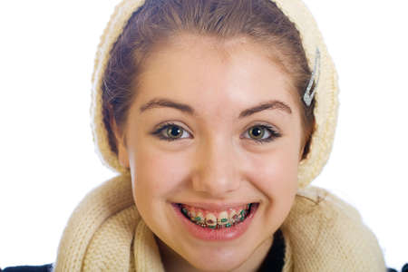 brace: young teenager with braces and a happy smile
