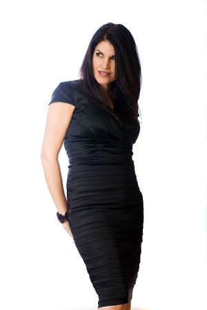 Sexy, middle aged woman in a black cocktail dress Stock Photo