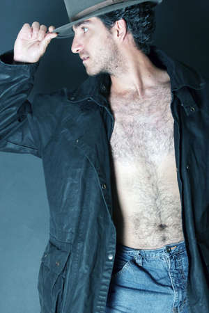 hairy chest: Man in hat and trench coat