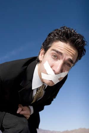 duct: Hombre de negocios con una cinta del conducto en su boca Foto de archivo