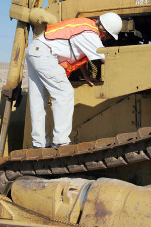 construction machinery: Construction worker on the construction machinery Stock Photo