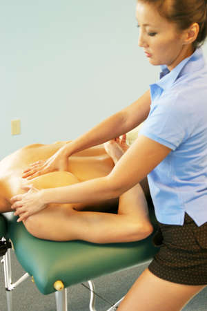 rejuvenate: Massage therapist giving a massage