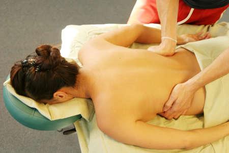 rejuvenate: Massage therapist giving back massage