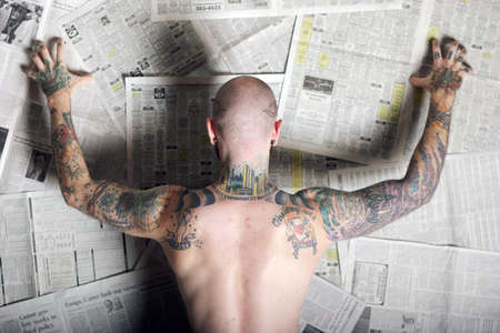 rebellious: Back of a man covered with tattoos