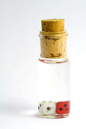 folkloristic: The old game is a bottle with two dice, this is a old   folkloristic game Stock Photo