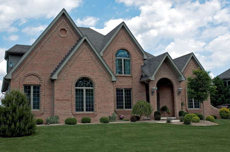 Fantastic detailed brickwork frames each window and the entranceway of this gorgeous home.