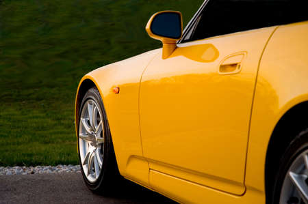 front end: Front end of a yellow sports car. Stock Photo