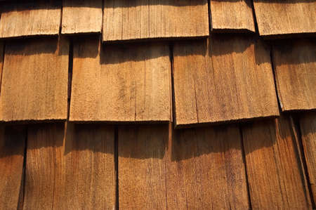 cedar shakes: Close- up of some cedar wood shingles. Makes a nice background image.