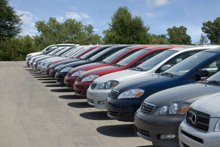 shiny car: New fuel efficient SUVs on a car dealers lot for sale. Stock Photo