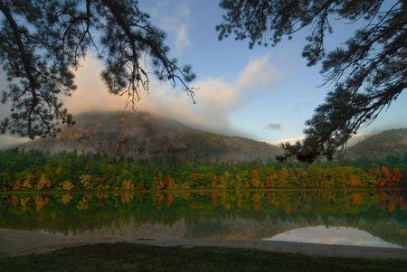 echo: Beautiful fall colors reflecting onto Echo Lake New Hampshire.