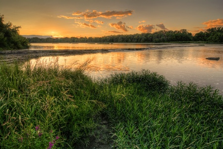 ohio: A beautiful warm summer sunset at Weir s Rapids along the Maumee river in Northwest Ohio