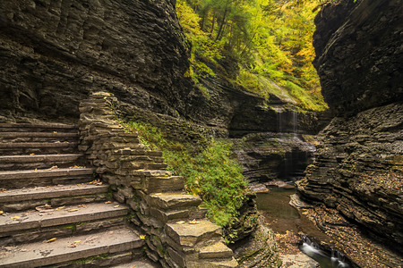 dozens: Watkins Glen waterfalls in New York during fall  A beautiful 1 75 mile long gorge with dozens of waterfalls along a stone trail   Stock Photo