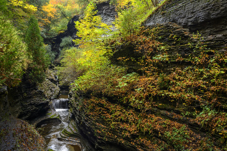 dozens: Watkins Glen waterfalls in New York during fall  A beautiful 1 75 mile long gorge trail with dozens of waterfalls
