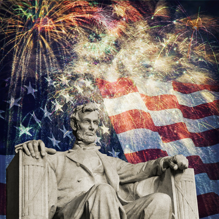 u s: Compsite photo of the statue of Abrahma Lincoln at the Lincoln Memorial with a flag and fireworks in the background  Nice patriotic image for Independence Day, Memorial Day, Veterans Day and Presidnets Day  Stock Photo