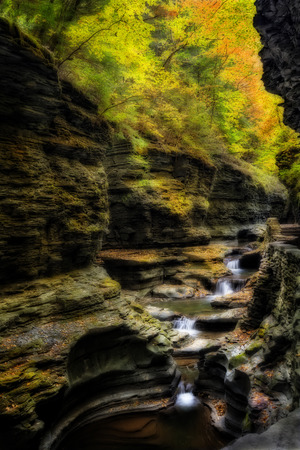 resemble: Watkins Glen waterfalls in New York during fall  A beautiful 1 75 mile long gorge with dozens of waterfalls  Photo has been given an effect to resemble a painting