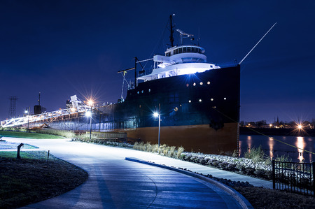 freighter: Night view of a lake freighter ship docked at the port of Toledo Ohio   Stock Photo