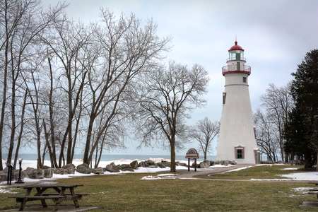 erie: The historic Marblehead Lighthouse in Northwest Ohio sits along the rocky shores of Lake Erie  Seen here in winter with snow on the ground