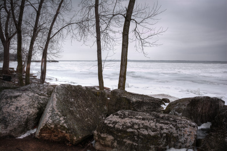 erie: The icy and cold rocky shore of Lake Erie In Northwest Ohio   Stock Photo
