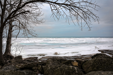 erie: The icy and cold rocky shore of the frozen Lake Erie in Northwest Ohio