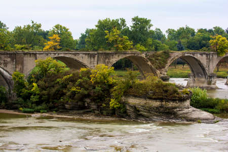 bout: The Roche de Bout rock outcrop with the ruins of the Interurban bridge which crosses the Maumee river in Northwest Ohio