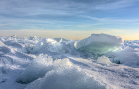 eire: Huge chunks of fresh water ice on Lake Eire in Northwest Ohio  Beautiful winter sunrise scene
