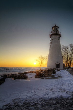 shores: The historic Marblehead Lighthouse in Northwest Ohio sits along the rocky shores of Lake Erie  Seen here in winter with snow on the ground